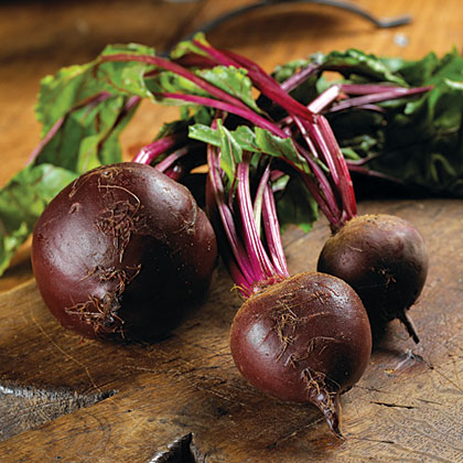 Red or golden beets are a great idea for beginning gardeners because they grow fast and are tolerant to soil moisture and sudden drops in temperature. You can also plant seedlings close, which is great for a small garden. Beets will be ripe for the plucking in about 50 days, once the greens are 6 inches high.