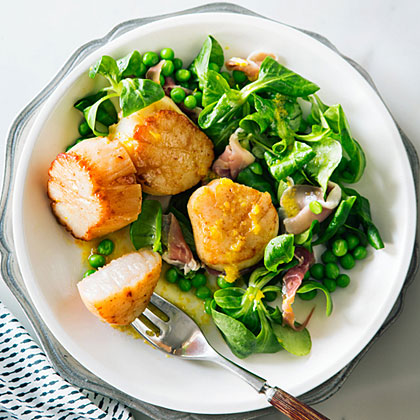 Scallop, Prosciutto, and Mâche Salad RecipeServe this party-worthy salad as soon as you make it--the tender mâche wilts fast.