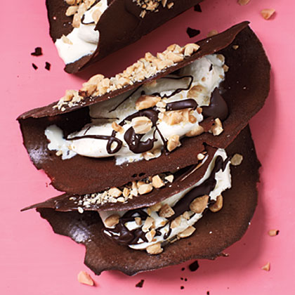 Chocolate Tacos RecipeCrisp chocolate shells envelop vanilla ice cream, chocolate sauce, and crushed peanuts for a truly unique dessert experience.