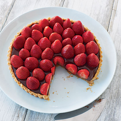 Strawberry-Chocolate Truffle Tart RecipeA shortbread cookie crust serves as the base of this luscious Strawberry-Chocolate Truffle Tart where the bright red gems crown the top of a chocolaty layer.