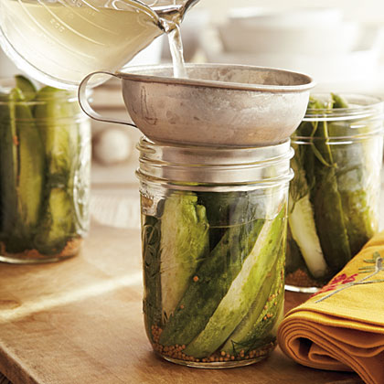 Step 3: Pack any recipe-specified solid ingredients (such as herbs or cut vegetables for a pickle) into the hot jars. Ladle or pour hot mixture or brine into the jars, using a widemouthed funnel to help keep the jar rims clean.