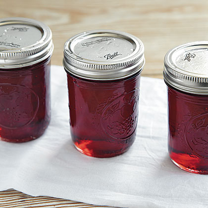 Step 9: Transfer jars to a towel-lined or wooden surface where they can rest undisturbed 12 to 24 hours. Do not tighten or adjust bands. Lids may make a popping noise as the jars cool. Not to worry. That's one sign of an airtight seal–and the sound of canning success.