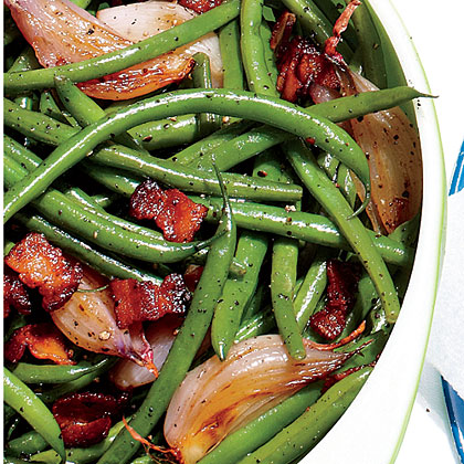 Skillet Green Beans RecipePencil-thin green beans laced with crispy bits of pan-fried bacon and Candied Jalapeños turn up the heat on tradition.