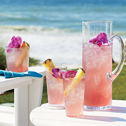 Pink-a-Colada RecipeCranberry juice lends a pinkish tint to this cocktail and contributes to its name—Pink-a-Colada. Brighten up this refreshing beverage with fresh fruit and edible flowers.