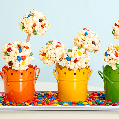 Popcorn-Marshmallow Pops RecipeUse M&M's your team's colors to make these fun popcorn pops that make for tasty treats as well as a fun tailgate decoration.