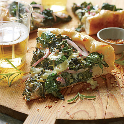 We like Skillet Kale Pizza not only for its flavor but for its seasonality. This pizza combines the sharp flavors of red pepper, red onion, and crumbly blue cheese with a hearty helping of fresh kale.Skillet Kale Pizza Recipe