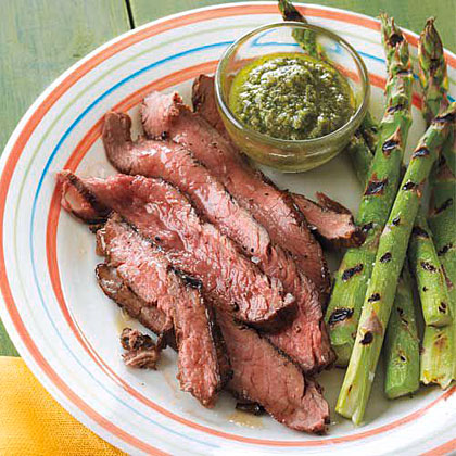 Flank Steak with Salsa Verde RecipeDip flank steak in easy homemade salsa verde for a winning weeknight supper. Serve with simple grilled vegetables.