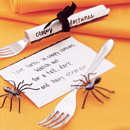 """Offer your friends fun and freaky predictions for the future. Write fortunes on 3"""" x 5"""" pieces of paper. Roll each piece of paper around silverware and tie with ribbon."""