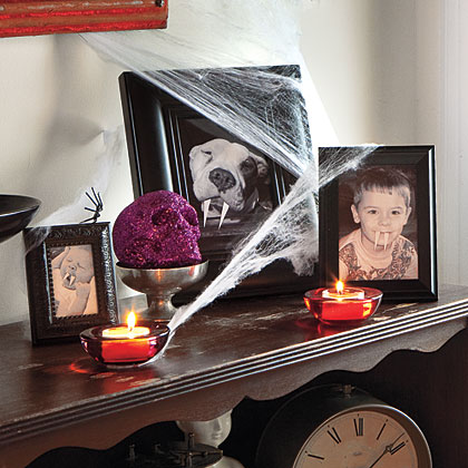 Copy or scan and print family photos in black and white, then cut small fangs out of white card stock and attach them to the photos with a glue stick. Display pictures around the house to give guests an unexpected jolt.