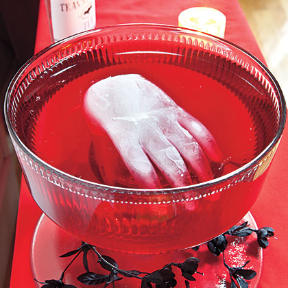 Give guests goose bumps by adding an icy hand to the punch. Fill a kitchen glove with water and knot to secure. Freeze at least 6 hours, then carefully cut glove away from ice with small scissors. Just before serving punch, float hand in bowl.