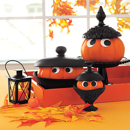 If you have a bunch of mismatched pots, plates and bowls, spray-paint them black to create a unified display. Fill your kitchenware with appropriately sized pumpkins, grab some construction paper and Craft glue and you'll have a hauntingly-good display.