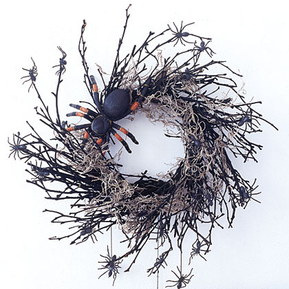Start with a twig wreath and spray-paint it black. Drape it with fake moss from a craft store. Glue on a large rubber spider. Finish the wreath by attaching smaller plastic spiders all over and dangling more of them from black thread.