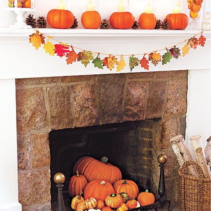 """Cut out leaf shapes. Place on plain side of patterned paper and trace; cut out. Punch hole in stem of each leaf. Cut a 3"""" length of yarn for each leaf. Thread yarn through hole. Cut a piece of yarn long enough to hang across mantel. Tie leaves to yarn."""