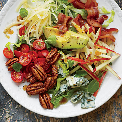 Waldorf Cobb Salad RecipeThis makes a company-perfect sidekick for anything roasted or grilled. The concentrated flavor of an apple cider reduction, plus a shot of sorghum syrup, add rich complexity, not just sweetness, to the vinaigrette.