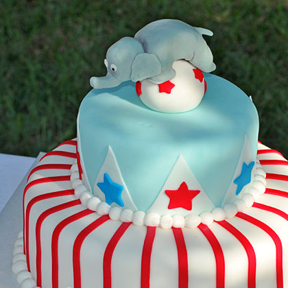 Use your too-cute cake as a centerpiece that adds to your decor before the guests arrive and dig in. The fondant elephant balancing on the ball is a classic circus moment, and the red stripes bring back memories of nights under the tent.