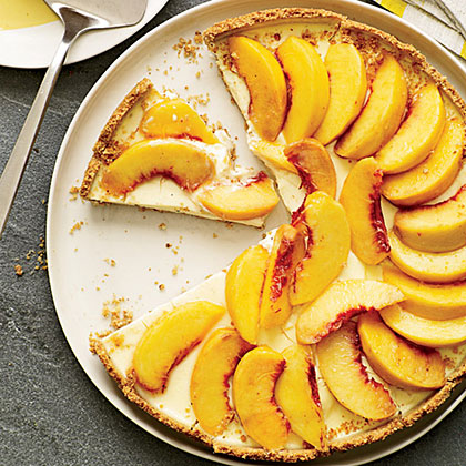 Creamy Peach Tart with Smoky Almond Crust RecipeAn almost-instant crust, made with vanilla wafer cookies and smoked almonds, is the secret to this simple and unusual tart.