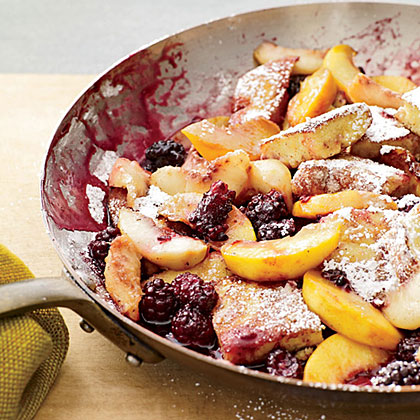 Kaiserschmarrn with Peaches RecipeKaiserschmarrn is a popular Austrian dessert that can also be eaten for breakfast. It's a light pancake, cut up while it's frying and topped with fruit and confectioners' sugar.