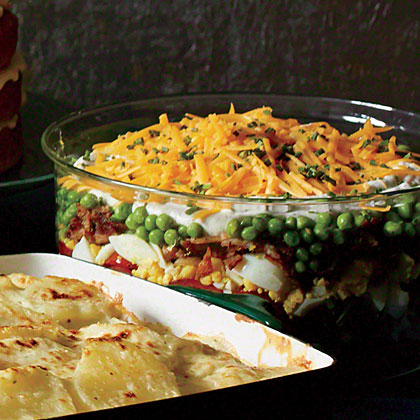 Make-Ahead Layered Salad RecipePrechopped veggies and precooked bacon and eggs help you pull this charmingly retro dish together in a flash. You can assemble the salad, cover tightly with plastic wrap, and refrigerate for up to 1 day.