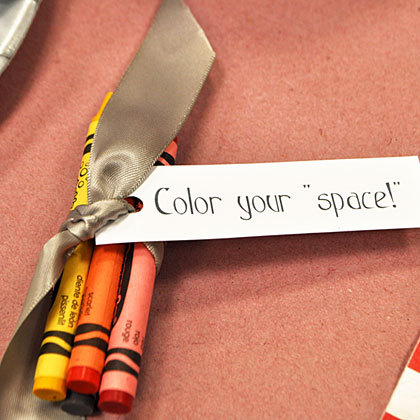 Greet guests with a packet of crayons at their spot at the table. Cover the table with butcher paper and encourage the kids to decorate it with stars, rockets, and other fun space-themed ideas. Then, when the party's over, the butcher paper provides easy cleanup for any drink spills or cake crumbs.