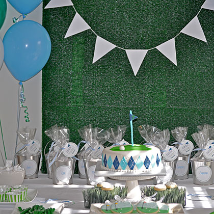 Set the scene for the perfect golf birthday party by bringing out all the classic elements of the game: turf, plaid, and argyle. From silver cup favors to cookies suspended on fake grass, this golf birthday party is ready for tee time.
