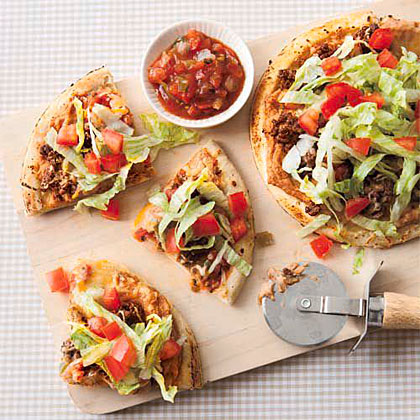 Taco Pizza RecipeRethink taco night with this inventive recipe. Instead of taco shells, use prebaked pizza crusts to hold your favorite toppings, like ground beef, refried beans, salsa, and sour cream.