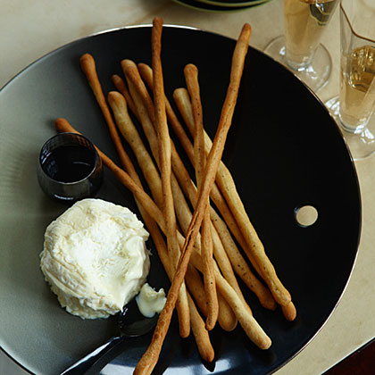 Black-Pepper Breadsticks RecipeScott Conant serves these tender, peppery breadsticks as a starter. He packs them into a tall glass or plates them with small wedges of La Tur cheese (a dense, buttery Piedmont cheese made from a blend of cow, sheep and goat milk), drizzled with aged balsamic vinegar and sprinkled with flaky sea salt.