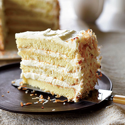 Towering Coconut Layer Cake RecipeThis cake couldn't be more traditional: four layers of rum-brushed yellow cake filled and frosted with a light and airy, coconut-scented meringue-buttercream.