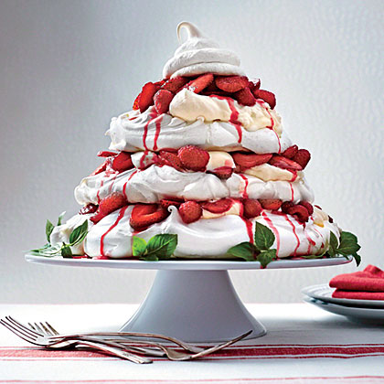 Red Berry Pavlova Tower RecipeLayer and fill this meringue turret up to one hour before serving for the best contrast of crunchy, chewy, and creamy textures.