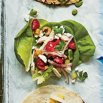 Greek Chicken Tacos RecipeCrisp lettuce cups offer a light, refreshing spin to this Greek salad-inspired taco, but feel free to use warm flour tortillas or pitas instead.