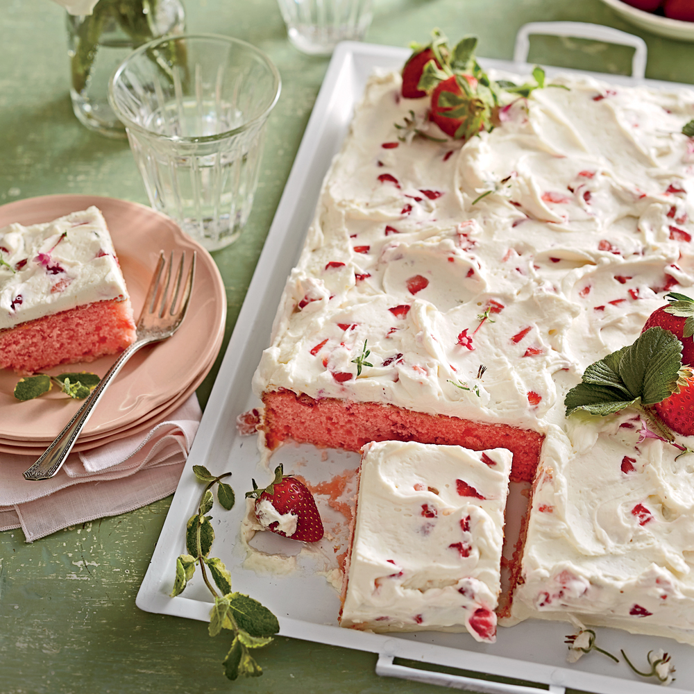 "Strawberries-and-Cream Sheet Cake RecipeTrust us: This simple and swoon-worthy sheet cake will be a keeper in your recipe box. File it under ""Springtime Crowd-pleaser."""
