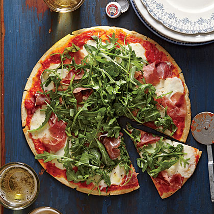 Prosciutto-Arugula Pizza RecipeWe love the thin crust of this pizza, which cooks up fast and as crisp as a cracker.