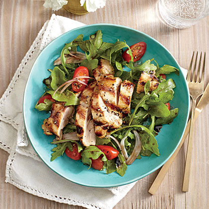 Grilled Lemon-Dijon Chicken Thighs with Arugula Salad RecipeThis light, quick main is perfect for warmer months. If you have 5 extra minutes, grill some vegetables to toss into the salad; try asparagus or red onion.