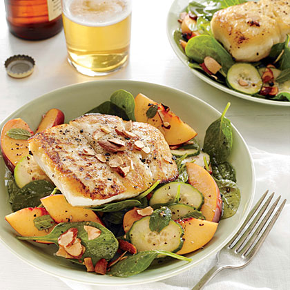 "Halibut and Peach Salad with Lemon-Mint Vinaigrette RecipeThis easy, breezy salad has been described as ""restaurant-quality"" by several of our reviewers. You can substitute another sustainable white fish (such as tilapia or striped bass) for the halibut, and pecans or hazelnuts for the almonds."