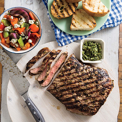 London Broil with Chimichurri RecipeHerb-marinated flank steak is incredible when grilled, sliced against the grain, and served with crusty Italian bread.