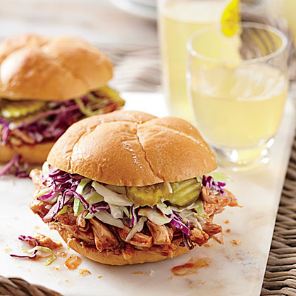 BBQ Chicken Sandwiches with Pickle Juice Slaw RecipeThis 15-minute recipe relies on rotisserie chicken and bottled barbecue sauce for convenience. Homemade pickle juice slaw top these sandwiches off with crunch and tang.