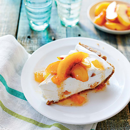 No-Bake Peach Pie RecipeThis luscious dessert comes together easily and is the perfect ending to summer supper with friends. Use the softest and juiciest peaches you have, even slightly overripe fruit. For added peach oomph, chop some of the topping and stir it into the filling.