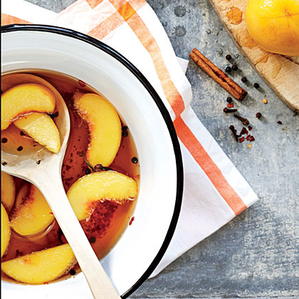 Quick Pickled Peaches RecipeThese gorgeously spiced, tangy-sweet peaches make a fantastic addition to a summer relish tray, or serve them on pound cake or alongside grilled pork or chicken. Look for peaches that are still a little firm; they will soften some in the warm liquid. If you start with very ripe peaches, they may oversoften by the time they are finished pickling.