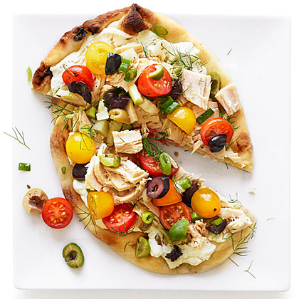 Take a classic French salad, pile it on Indian flatbread, and you have a fresh, foolproof take on pizza that's perfect for those nights when you don't feel like cooking.