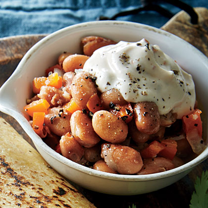 Simmered Pinto Beans with Chipotle Sour Cream Recipe | MyRecipes