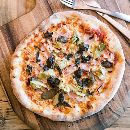 Capricciosa Pizza (Ham, Mushrooms, Mozzarella, and Artichokes)