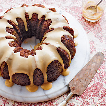 """Spiced Caramel Bundt Cake RecipeCinnamon, ginger, and nutmeg give this gluten-free cake its signature spiced flavor, and applesauce lends moistness while allowing you to use less oil. A drizzle of golden caramel syrup is the finishing touch, making this the perfect """"ta-da!"""" dessert to serve at your next dinner party or ladies' tea."""