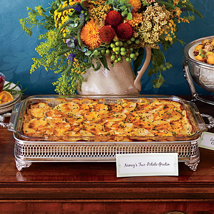 "Sweet and yukon gold potatoes are the focal point of this gratin that's perfect for the holidays. Fresh parsley and chives deliver a fresh punch that adds an unbeatable flavor. Our favorite casserole cheese, gruyère, tops off the casserole. ""This luscious gratin strikes a happy middle chord for those hungry for potatoes and those vying for a sweet potato casserole."" --Nancy Vienneau, author of Third Thursday Community Potluck Cookbook, from which this recipe was adapted."