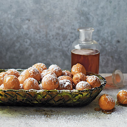 Struffoli RecipeAh, struffoli! These little Neopolitan dough balls are fried quickly to give them a light, delicious cake inside and crunchy outside layer, and then covered in honey and powdered sugar. Serve with coffee and savor each little indulgent bite.