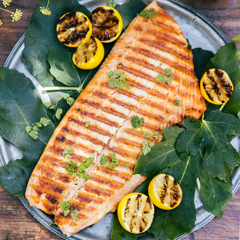 Grilled salmon with caramelized lemons recipe myrecipes for Best fish to grill
