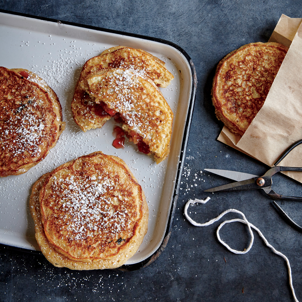 PB&J Stuffed Multigrain Pancakes                            RecipePeanut butter powder is the secret to adding intense nutty flavor (without a lot of fat) to these jam-stuffed pancakes.