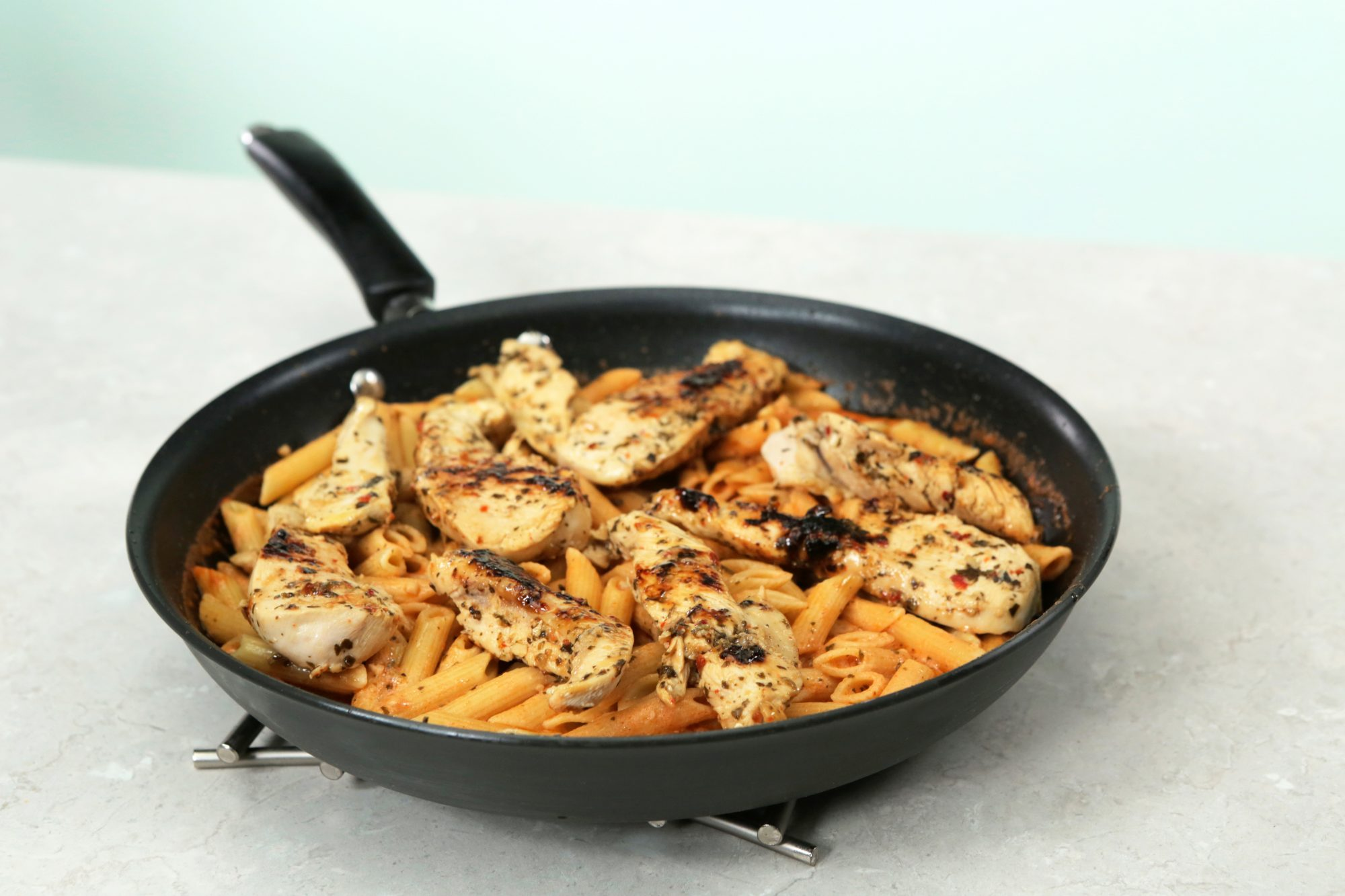 <p>Garlic Pesto Chicken with Tomato Cream Penne</p>