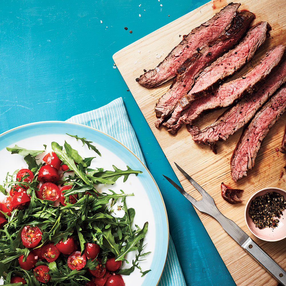 Flank Steak with Arugula & Herbed Tomato Salad Recipe | MyRecipes