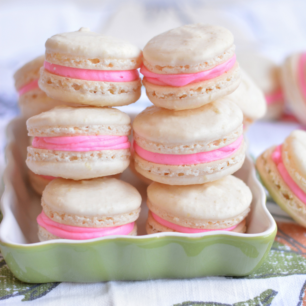 """These """"Pretty in Pink"""" cookies are a light and airy sweet treat for macaron lovers everywhere. Made in the classic French way, these macarons feature two Meringue cookies and a luscious creamy center.Basic Vanilla Macarons                            Recipe"""