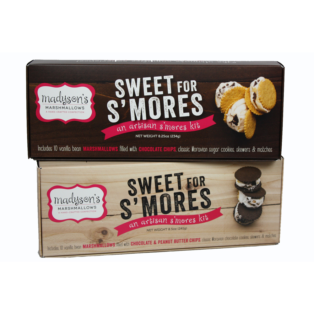 Madyson's Marshmallow DIY S'mores KitWho wants more S'mores? This Artisan S'mores Kit from Madyson's Marshmallows comes complete with hand-made chocolate-filled marshmallows, classic Moravian cookies, skewers, and matches! This kit is perfect for that DIY-er with a sweet tooth.