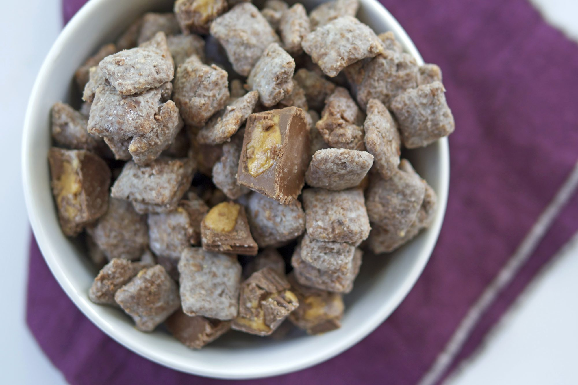 <p>Triple-Chocolate Peanut Butter Cup Puppy Chow</p>